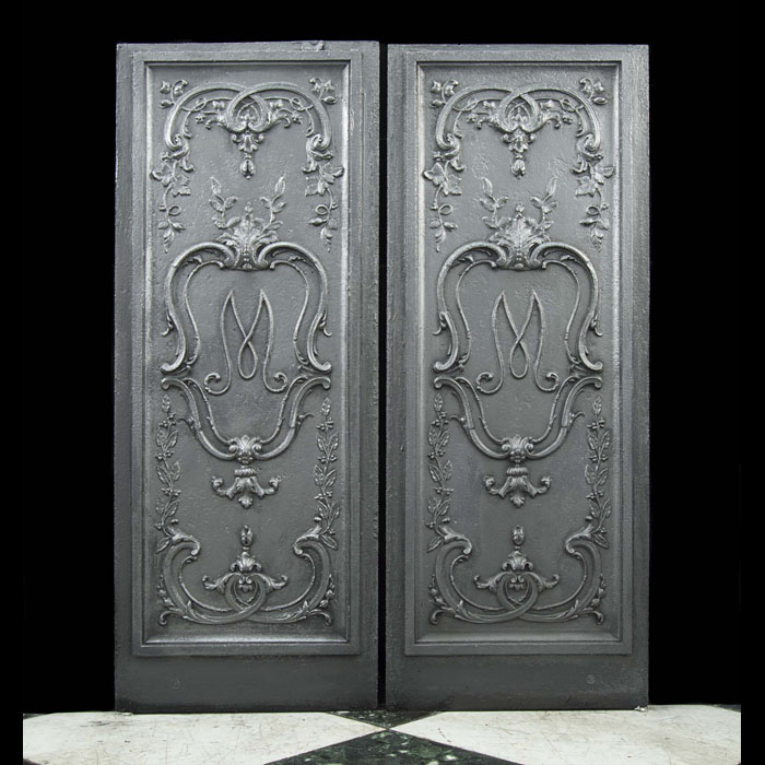A pair of 19th century monogrammed fireplace panels