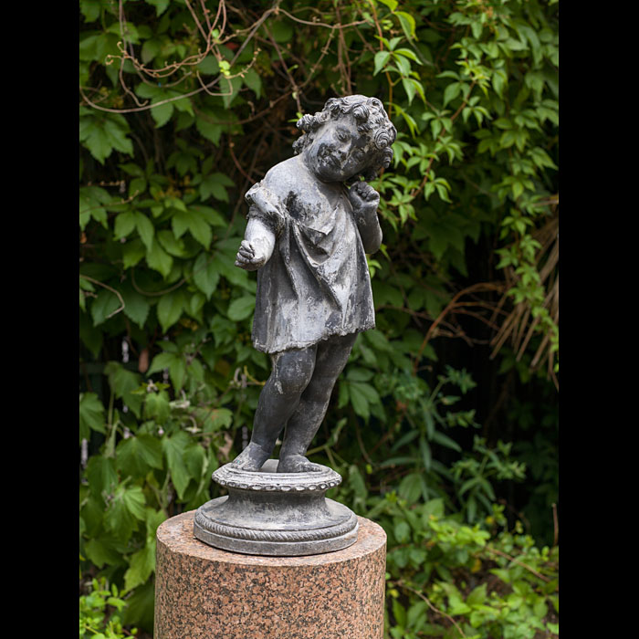 A lead garden figure of a listening child