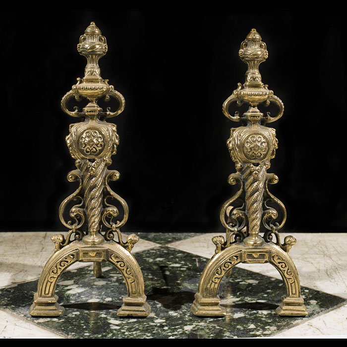 A pair of Renaissance style brass andirons