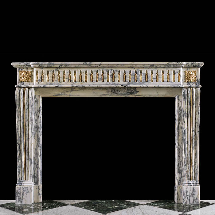 An antique Louis XVI style Arabescato marble chimneypiece.