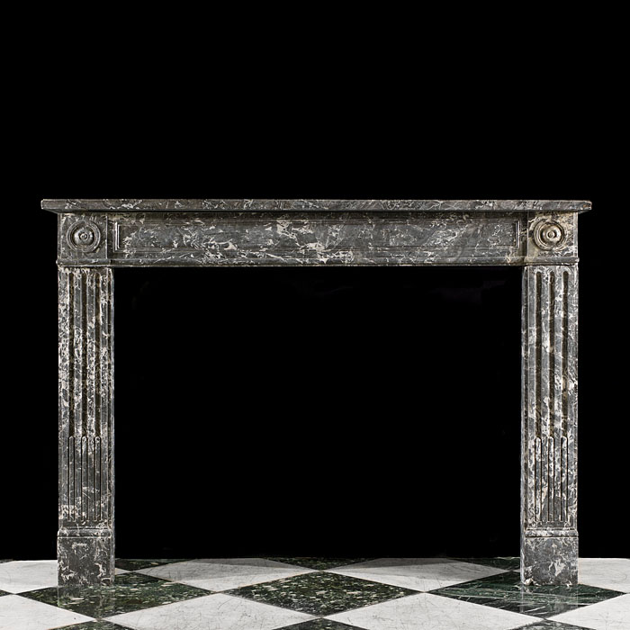 An Antique Louis XVI style fireplace surround in St Anne's Marble