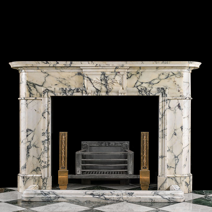 An antique Belgian Louis XVI style Pavonazza marble fireplace.
