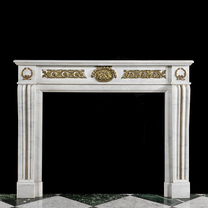 A Louis XVI Statuary Marble fire surround