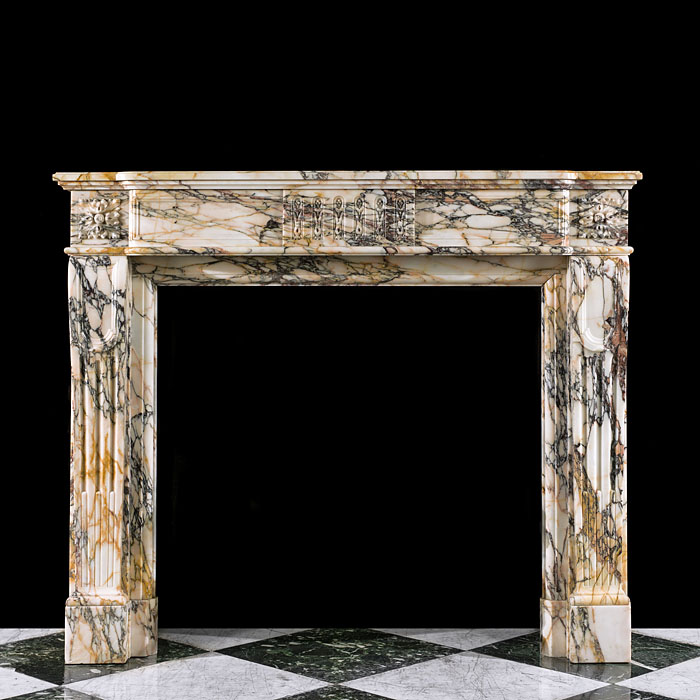 A Louis XVI Pavonazza Marble Fireplace