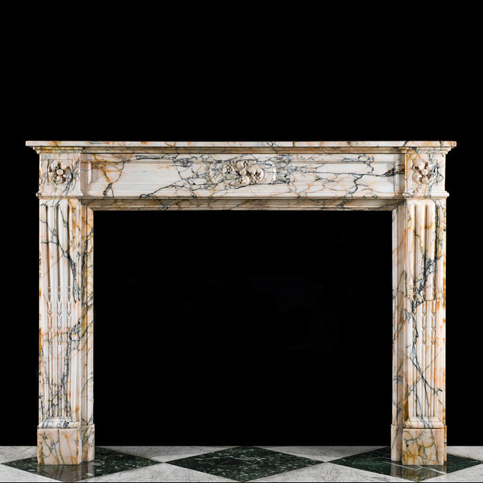 A Louis XVI Style Skyros Marble Fireplace