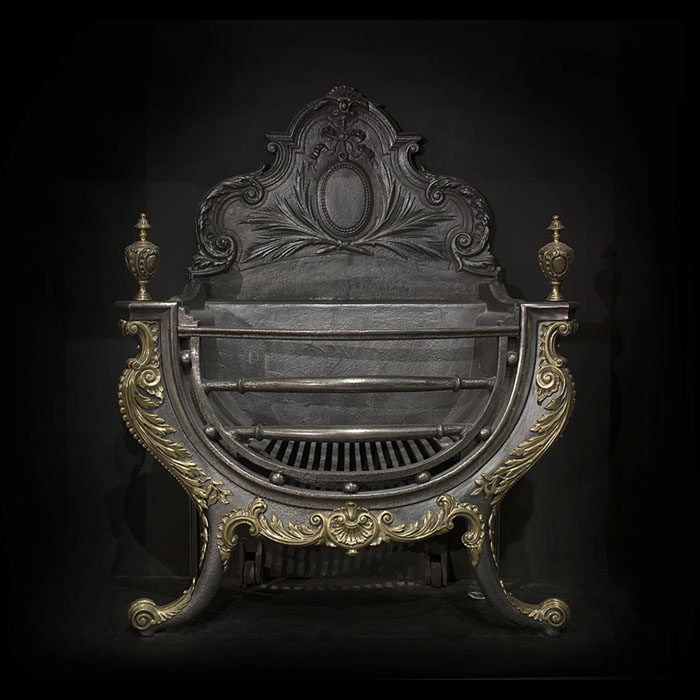 A Large Rococo Style Cast Iron Fire Grate