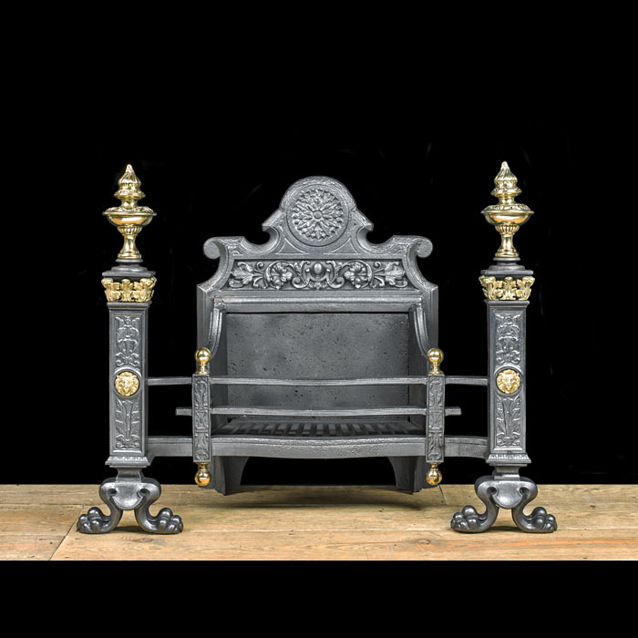 A Baroque style iron and brass firegrate