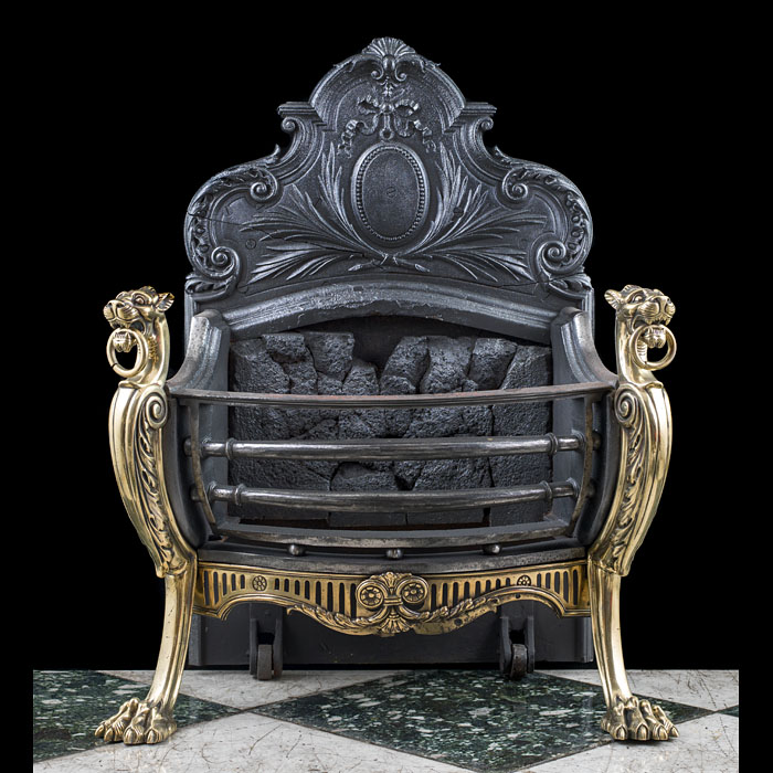 A Rococo style antique griffin fire basket