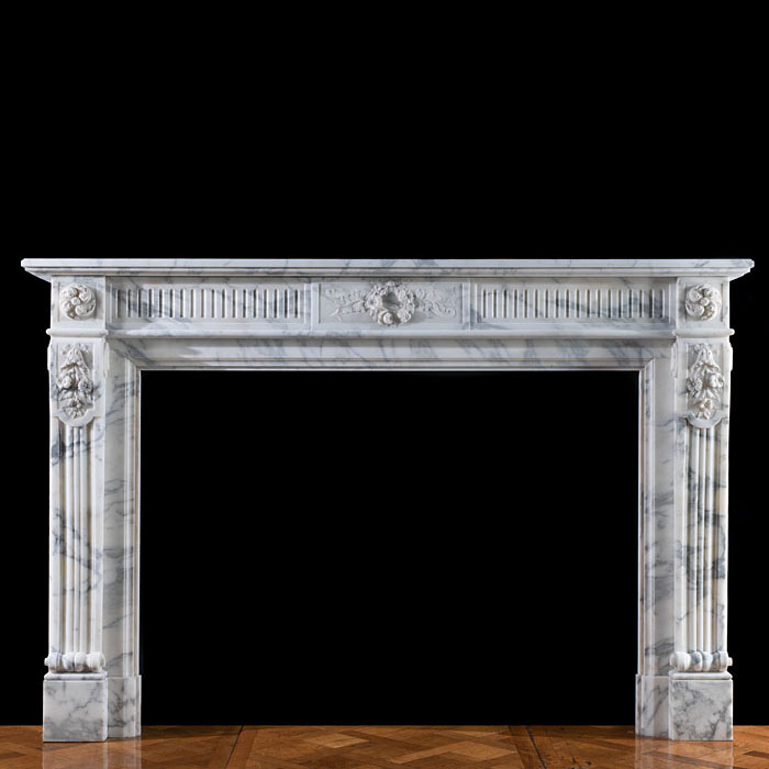 A Louis XVI style Arabascato fireplace