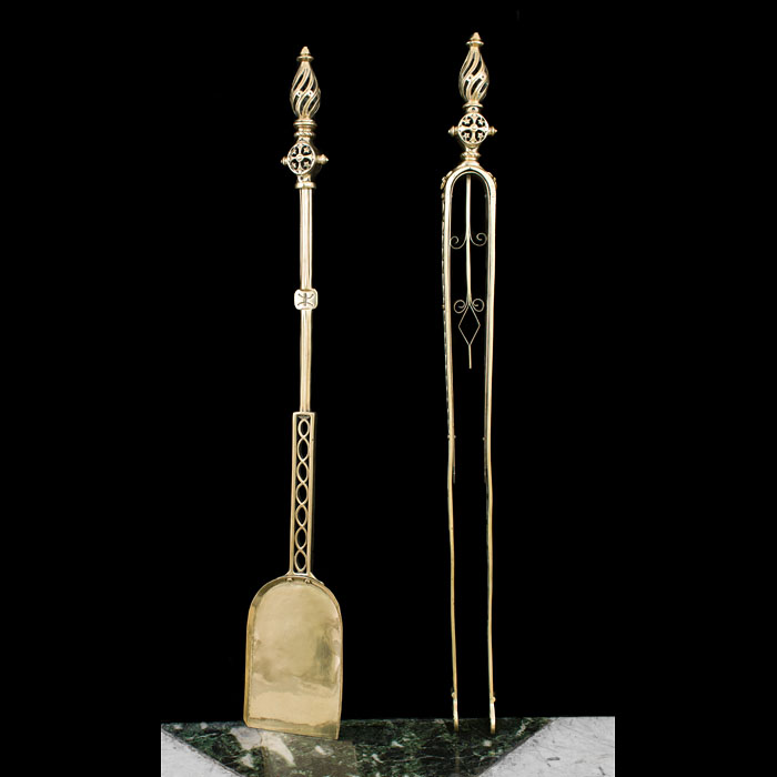 A Large Gothic Revival pair of brass firetools