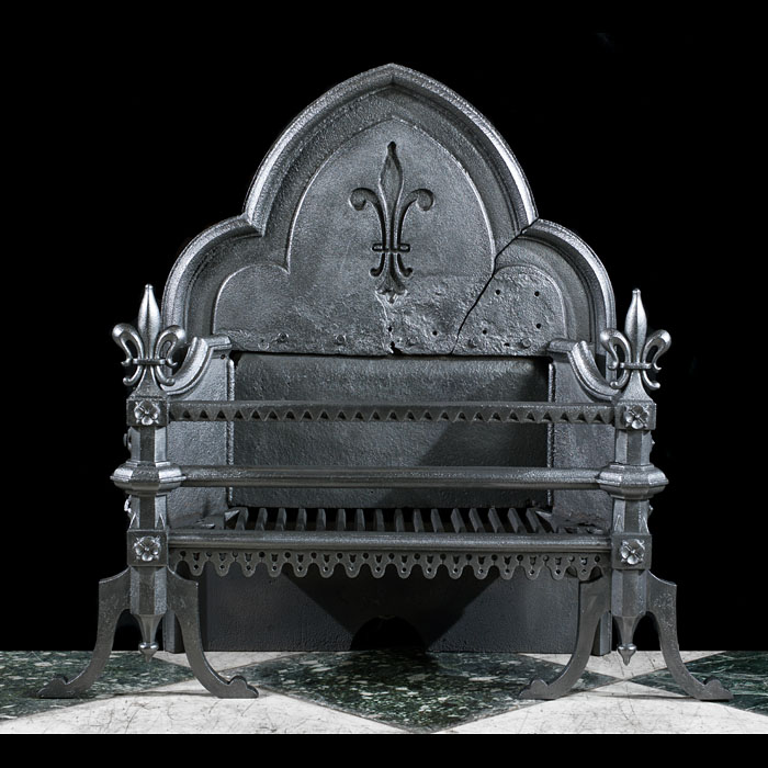 A large cast iron Gothic Revival fire grate
