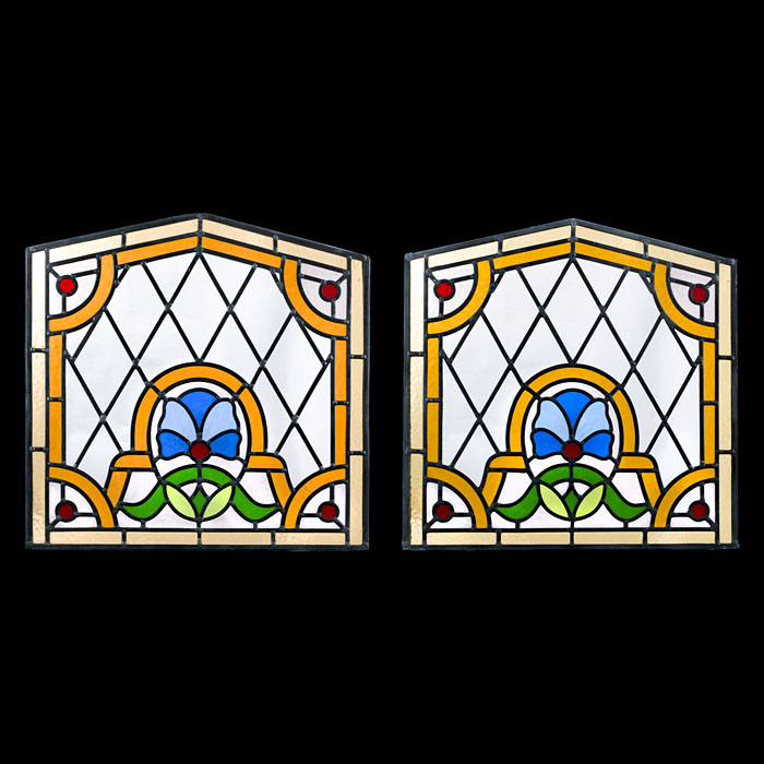 A decorative pair of stained glass panels