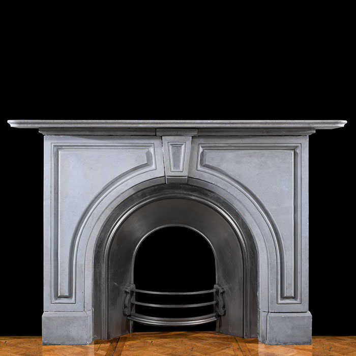 An arched limestone Victorian fireplace