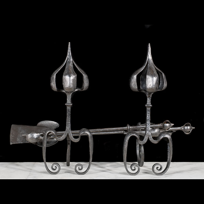 An Art Nouveau set of fire tools and rests