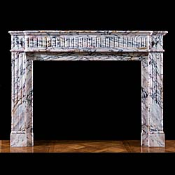 A Breche Violette Marble fireplace
