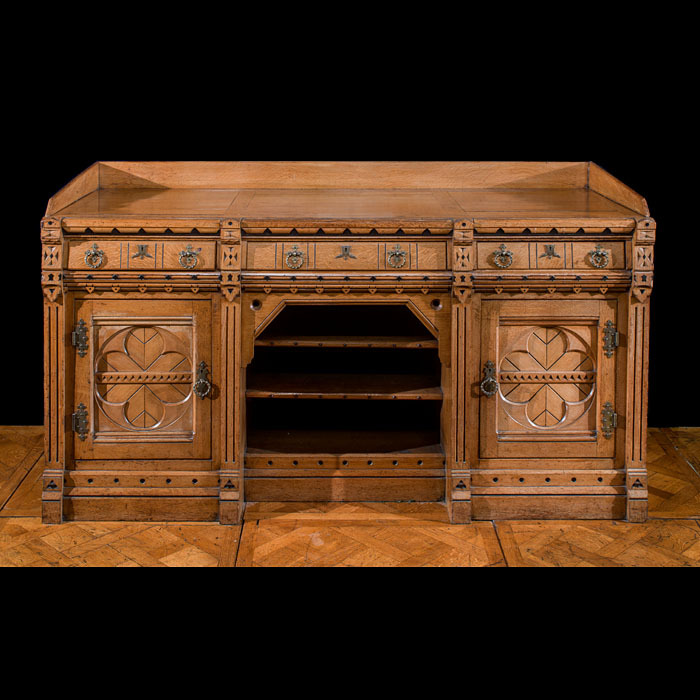 A Gothic Revival inlaid oak sideboard