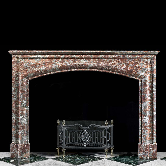 An Arched Baroque Style Marble Fireplace